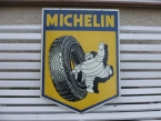 "1960 double sided bracket hung Michelin Tyres lithograph shield sign 30"" x 24""."